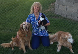 Dr. Many Buhman with two dogs and a cat