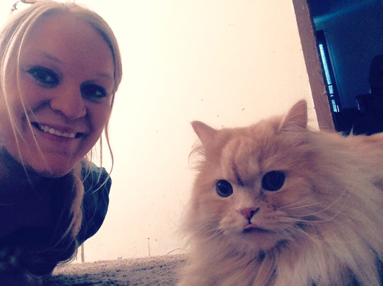 Team member Nicole with her fluffy cat